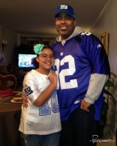 My daughter and I celebrate a NY Giants win in Superbowl XLVI vs. the Patriots.