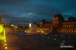 "The moon shines over the Louvre during ""magic hour""."