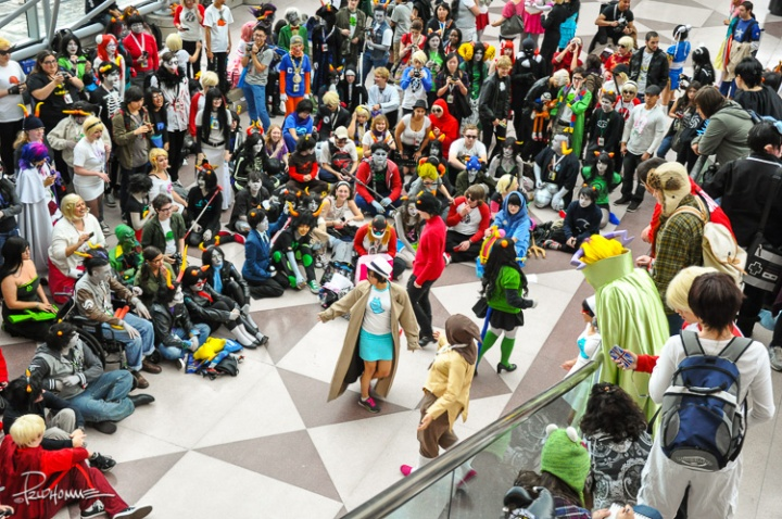 Spectators and costumed fans gather about for some cosplay fun.