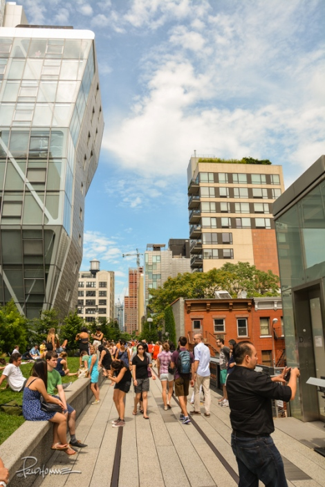 The park was crowded on this Saturday afternoon. On either side of the High Line are beautiful tenement and office buildings.