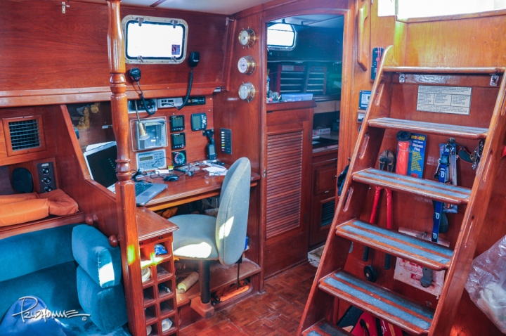 Navigation station with laptop, maps, radio and GPS unit.